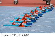 Купить «Blue and Orange Starting Blocks in Track and Field», фото № 31362691, снято 10 июня 2018 г. (c) easy Fotostock / Фотобанк Лори