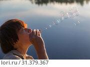 Купить «Woman and soap bubbles», фото № 31379367, снято 25 июля 2015 г. (c) Argument / Фотобанк Лори