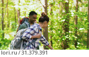 Купить «group of friends with backpacks hiking in forest», видеоролик № 31379391, снято 29 июня 2019 г. (c) Syda Productions / Фотобанк Лори