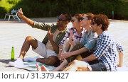 Купить «friends with drinks taking selfie by smartphone», видеоролик № 31379427, снято 29 июня 2019 г. (c) Syda Productions / Фотобанк Лори