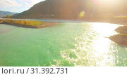 Купить «Low altitude flight over fresh fast mountain river with rocks at sunny summer morning.», видеоролик № 31392731, снято 29 марта 2019 г. (c) Александр Маркин / Фотобанк Лори