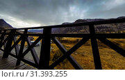 Купить «Timelapse of wooden fence on high terrace at mountain landscape with clouds. Horizontal slider movement», видеоролик № 31393255, снято 20 марта 2018 г. (c) Александр Маркин / Фотобанк Лори