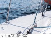 Купить «Background - yachting. fragment of the hull of a sailing vessel with rigging against the backdrop of water», фото № 31394027, снято 24 июня 2019 г. (c) Евгений Харитонов / Фотобанк Лори