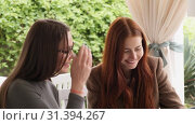 Купить «Close up view of stylish female colleagues talking about new business project slow motion», видеоролик № 31394267, снято 4 августа 2020 г. (c) Denis Mishchenko / Фотобанк Лори