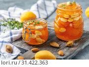 Купить «Apricot homemade jam with almonds in glass jars», фото № 31422363, снято 7 июля 2019 г. (c) Марина Сапрунова / Фотобанк Лори