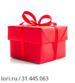 Купить «Red gift box with ribbon bow studio isolated on white background Christmas New Year birthday Valentines day anniversary concept», фото № 31445063, снято 8 декабря 2018 г. (c) easy Fotostock / Фотобанк Лори
