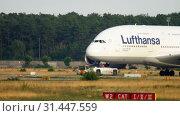 Купить «Towing Lufthansa Airbus 380», видеоролик № 31447559, снято 18 июля 2017 г. (c) Игорь Жоров / Фотобанк Лори