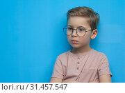 Купить «Little cute boy in glasses posing thoughtfully», фото № 31457547, снято 10 марта 2019 г. (c) Pavel Biryukov / Фотобанк Лори