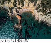Купить «Drone point of view directly from above Palma de Mallorca rocky seaside coves turquoise colored Mediterranean Sea waters, nature background, Balearic Islands, Spain», фото № 31468107, снято 27 мая 2019 г. (c) Alexander Tihonovs / Фотобанк Лори