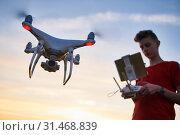 Купить «drone flying. copter pilotage at sunset», фото № 31468839, снято 22 июня 2019 г. (c) Дмитрий Калиновский / Фотобанк Лори