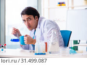 Купить «Young male chemist working in the lab», фото № 31499087, снято 18 марта 2019 г. (c) Elnur / Фотобанк Лори