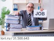 Купить «Aged male employee unhappy with excessive work», фото № 31500643, снято 15 марта 2019 г. (c) Elnur / Фотобанк Лори