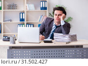 Купить «Young male employee working in the office», фото № 31502427, снято 18 февраля 2019 г. (c) Elnur / Фотобанк Лори