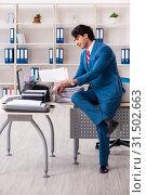 Купить «Young employee making copies at copying machine», фото № 31502663, снято 14 декабря 2018 г. (c) Elnur / Фотобанк Лори