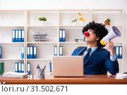 Купить «Young clown businessman working in the office», фото № 31502671, снято 14 декабря 2018 г. (c) Elnur / Фотобанк Лори