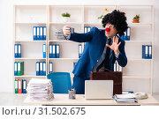 Купить «Young clown businessman working in the office», фото № 31502675, снято 14 декабря 2018 г. (c) Elnur / Фотобанк Лори