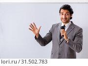 Купить «Young handsome businessman in front of whiteboard», фото № 31502783, снято 10 октября 2018 г. (c) Elnur / Фотобанк Лори