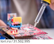 Professional repairman repairing computer in workshop. Стоковое фото, фотограф Elnur / Фотобанк Лори