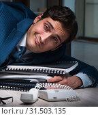 Купить «Businessman working overtime long hours late in office», фото № 31503135, снято 9 октября 2017 г. (c) Elnur / Фотобанк Лори