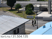 Купить «UN peacekeepers soldier. The demarcation line between South and North Korea», фото № 31504135, снято 5 мая 2019 г. (c) Знаменский Олег / Фотобанк Лори