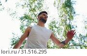 Купить «Young bearded man with tattoos performing locking dancing in the park», видеоролик № 31516295, снято 4 апреля 2020 г. (c) Константин Шишкин / Фотобанк Лори