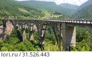 Купить «Plevlya, Montenegro - June 11. 2019. Dzhurdzhevich bridge over the river Tara», видеоролик № 31526443, снято 25 июня 2019 г. (c) Володина Ольга / Фотобанк Лори
