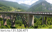 Купить «Plevlya, Montenegro - June 11. 2019. Dzhurdzhevich bridge over the river Tara», видеоролик № 31526471, снято 25 июня 2019 г. (c) Володина Ольга / Фотобанк Лори