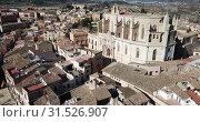 Купить «Aerial view of Spanish city of Montblanc and church of Santa Maria in sunny day», видеоролик № 31526907, снято 14 февраля 2019 г. (c) Яков Филимонов / Фотобанк Лори
