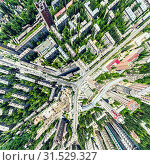 Купить «Aerial city view with crossroads and roads, houses, buildings, parks and parking lots. Sunny summer panoramic image», фото № 31529327, снято 21 января 2020 г. (c) Александр Маркин / Фотобанк Лори