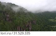 Купить «Уральские горы. Розовые скалы в тумане. Ural Mountains. Pink rocks in the mist.», видеоролик № 31529335, снято 12 июля 2019 г. (c) Евгений Романов / Фотобанк Лори