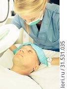 Купить «Woman doctor is massaging face of patient after the procedure», фото № 31531035, снято 15 октября 2019 г. (c) Яков Филимонов / Фотобанк Лори