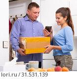 Купить «Man delivered box to happy housewife at home», фото № 31531139, снято 5 июня 2020 г. (c) Яков Филимонов / Фотобанк Лори
