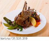 Купить «Lamb ribs served with vegetables», фото № 31531319, снято 16 июля 2019 г. (c) Яков Филимонов / Фотобанк Лори