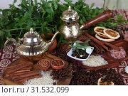 Купить «Чайник и кофеварка на столе с индийскими специями», фото № 31532099, снято 14 июля 2019 г. (c) Марина Володько / Фотобанк Лори
