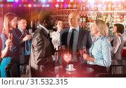 Купить «Men and woman at corporate party», фото № 31532315, снято 25 марта 2019 г. (c) Яков Филимонов / Фотобанк Лори