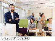 Купить «businessman with arms crossed in busy modern coworking space», фото № 31532343, снято 1 августа 2018 г. (c) Яков Филимонов / Фотобанк Лори