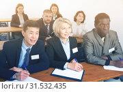 Купить «Group of business people listening to presentation», фото № 31532435, снято 12 февраля 2018 г. (c) Яков Филимонов / Фотобанк Лори