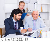 Купить «Employees are demonstrating reports on laptop to mature boss», фото № 31532499, снято 27 июня 2017 г. (c) Яков Филимонов / Фотобанк Лори
