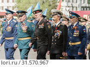 Купить «Veterans of different types of troops, in the parade. Orenburg, Russia - May 9, 2019: Victory Parade on Lenin Square», фото № 31570967, снято 9 мая 2019 г. (c) Вадим Орлов / Фотобанк Лори