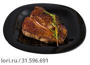 Купить «Grilled beef steak with rosemary», фото № 31596691, снято 29 июня 2018 г. (c) Яков Филимонов / Фотобанк Лори
