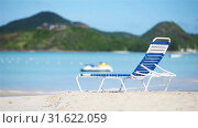 Sunbed on white tropical caribbean beach. Стоковое видео, видеограф Дмитрий Травников / Фотобанк Лори