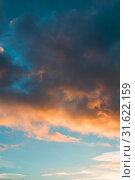 Купить «Sunset sky background -pink, orange and blue dramatic colorful clouds lit by evening sunshine. Vast sunset sky landscape», фото № 31622159, снято 21 ноября 2018 г. (c) Зезелина Марина / Фотобанк Лори