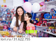 Купить «Smiling female and girl with gifts and balloons in the candy store», фото № 31622755, снято 22 января 2018 г. (c) Яков Филимонов / Фотобанк Лори