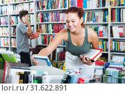 Купить «Girl looking for new literature», фото № 31622891, снято 16 сентября 2016 г. (c) Яков Филимонов / Фотобанк Лори