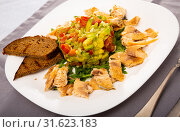Купить «Grilled trout fillet served with salad guacamole with fresh tomatoes», фото № 31623183, снято 18 июля 2019 г. (c) Яков Филимонов / Фотобанк Лори
