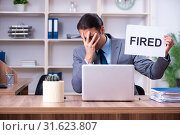 Купить «Young male employee being fired from his work», фото № 31623807, снято 17 апреля 2019 г. (c) Elnur / Фотобанк Лори