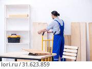 Купить «Young male carpenter working indoors», фото № 31623859, снято 9 апреля 2019 г. (c) Elnur / Фотобанк Лори