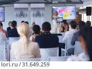 Купить «Female speaker announcing award in a business seminar», фото № 31649259, снято 16 марта 2019 г. (c) Wavebreak Media / Фотобанк Лори