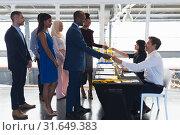 Купить «Business people checking in at conference registration table», фото № 31649383, снято 16 марта 2019 г. (c) Wavebreak Media / Фотобанк Лори