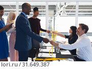 Купить «Business people checking in at conference registration table», фото № 31649387, снято 16 марта 2019 г. (c) Wavebreak Media / Фотобанк Лори